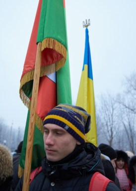 Young man holds flag of Kryvyi Rih city