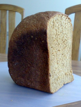 This whole wheat bread has no raisins. Compare the color with the loaf pictured below.