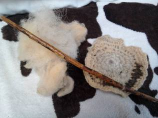 Raw fleece, a stick and finished product