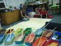 All the colours of the rainbow... North Rigton children help map a design..