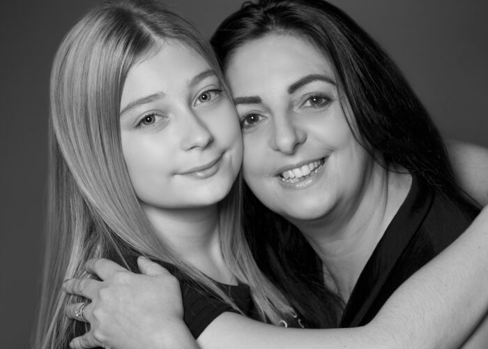 mother and daughter photo sitting in hull