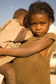 Malagasy girl holding her baby brother