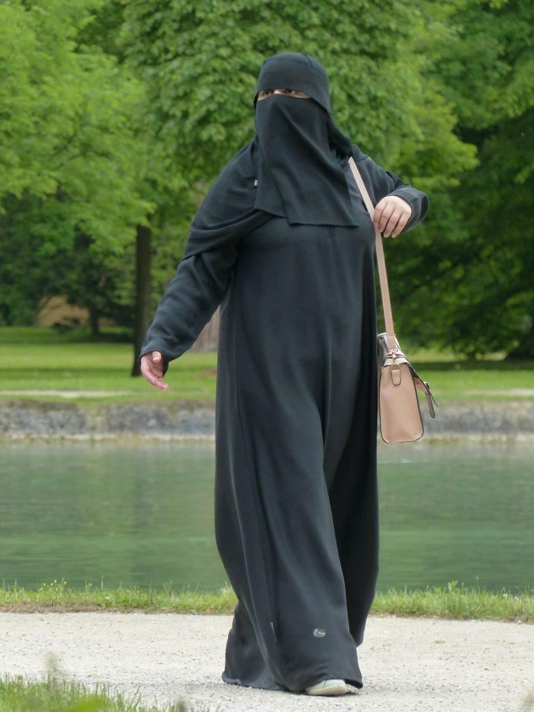 woman in Niqab walking in park
