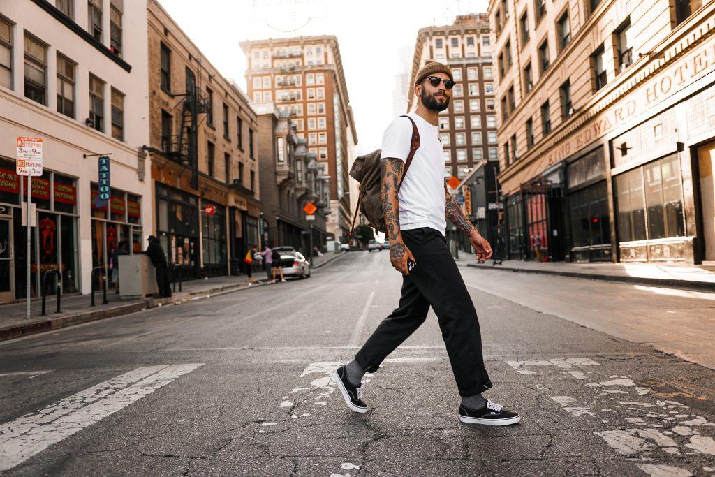 person walking across street