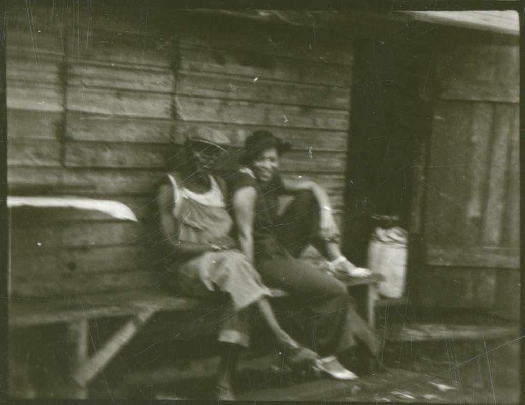 Zora Neale Hurston sitting with man