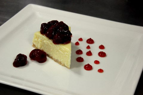 Cheesecake topped with Strawberry Coulis, Yumm