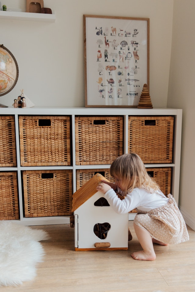 One of our toy storage ideas is to use woven baskets.