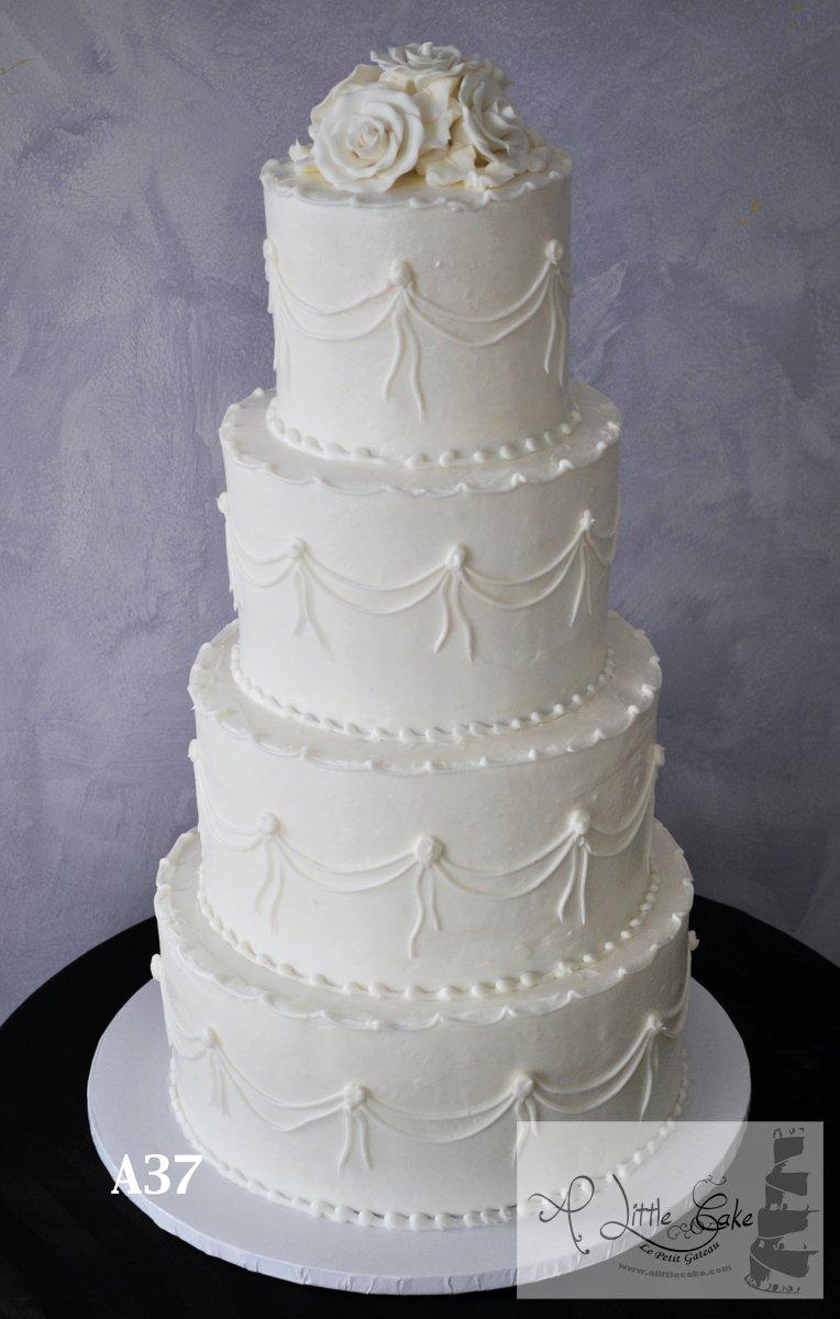 A37 Buttercream Wedding Cake With Wrap Around Floral Design