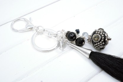 a black indonesian bead bag charm