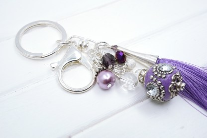 a purple indonesian bead bag charm