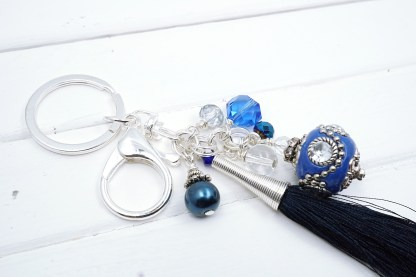 A Blue indonesian bead bag charm