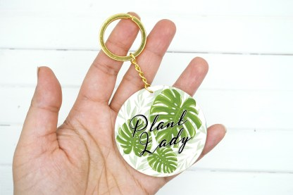 plant lady keychain with monstera leaves graphic