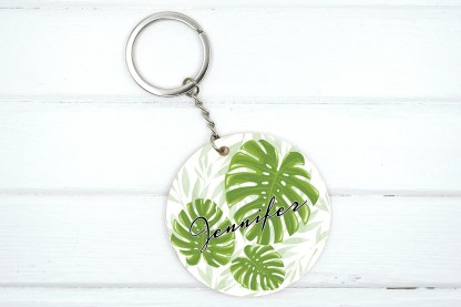 name keychain with monstera leaf graphics