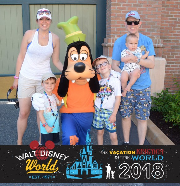 The whole family with Goofy at Walt Disney world