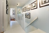 Painting out wood and addition of photo gallery expands space