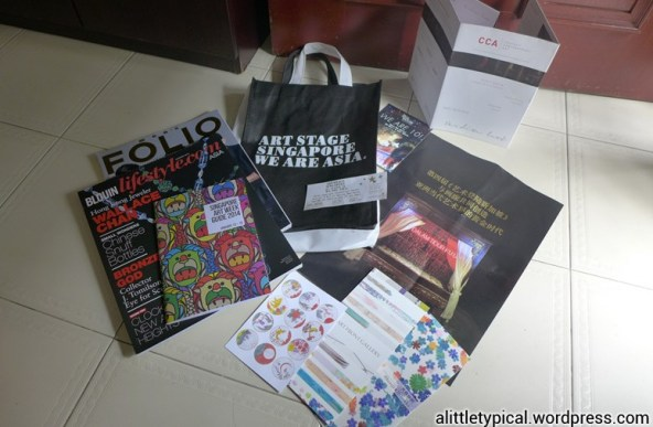 Tote bag of magazines and pamphlet.