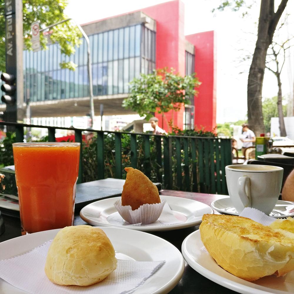 Brazilian breakfast with salgados and papaya juice in a padaria - 10 things to do and see in São Paulo | Aliz's Wonderland