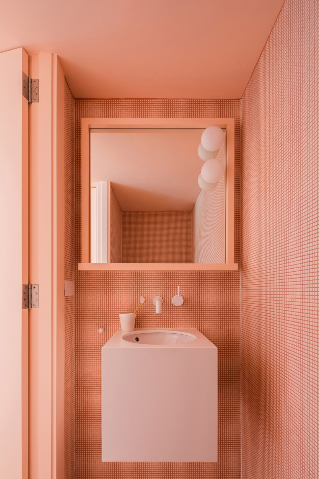Remodelista cute coral-pink bathroom - Warm up your home with pink wall colour | Aliz's Wonderland