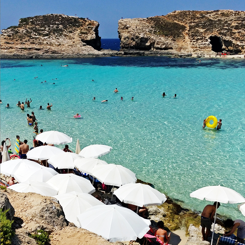 The crystal clear azure water in Blue Lagoon, Comino - Best beaches in Malta | Aliz's Wonderland