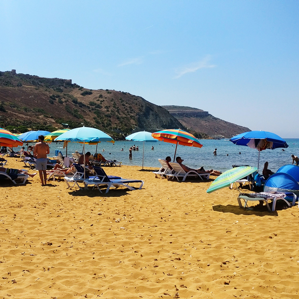 Ir-Ramla I-Hamra (Red Beach) is Gozo's largest sandy beach with golden-reddish sand - Best beaches in Malta | Aliz's Wonderland