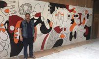 الفنان التشكيلي مصطفى الزوفري يبصم على عمل فني رائع بمحطة الشمال ببروكسيل .