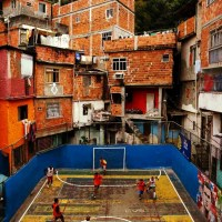 People Take Part in a Soccer Match Held at The Tavares Bastos Slum in Rio De Janeiro