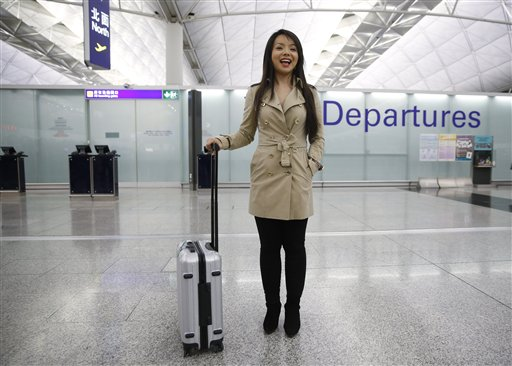 Canada's Miss World contestant Anastasia Lin walks at the departure hall after she was denied entry to mainland China, at Hong Kong International Airport in Hong Kong, Thursday, Nov. 26, 2015. Miss World Canada was barred from entering China on Thursday to take part in this year's pageant in the southern island province of Hainan, a friend of the outspoken Chinese-Canadian contestant said. Lin was prevented from boarding her connecting flight in Hong Kong, Caylan Ford said in an email. She said authorities gave no reason. (AP/Kin Cheung)