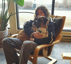 Dash the Boxer cuddled in my lap at the vet hospital.