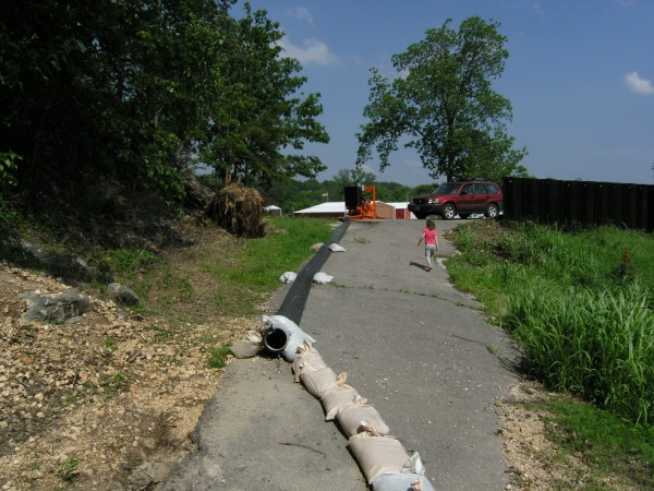 Pumping set up and a floodwall atop a levee