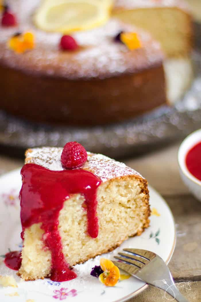 Raspberry sauce over French lemon yogurt cake