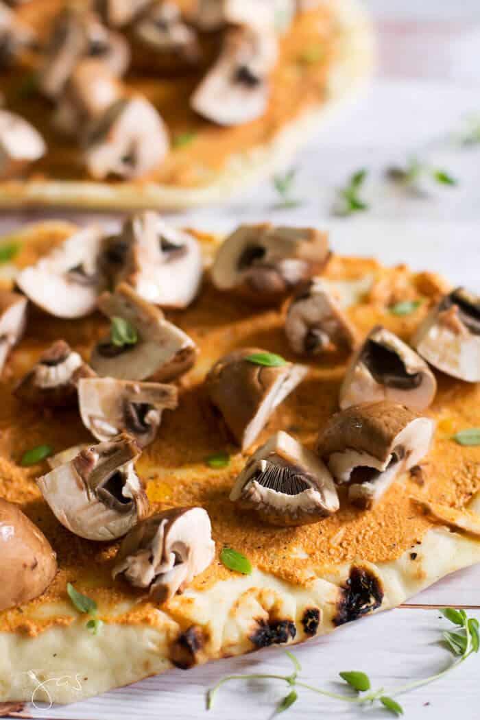 Flatbread baby portobello mushroom and goat cheese pizza ready for the oven