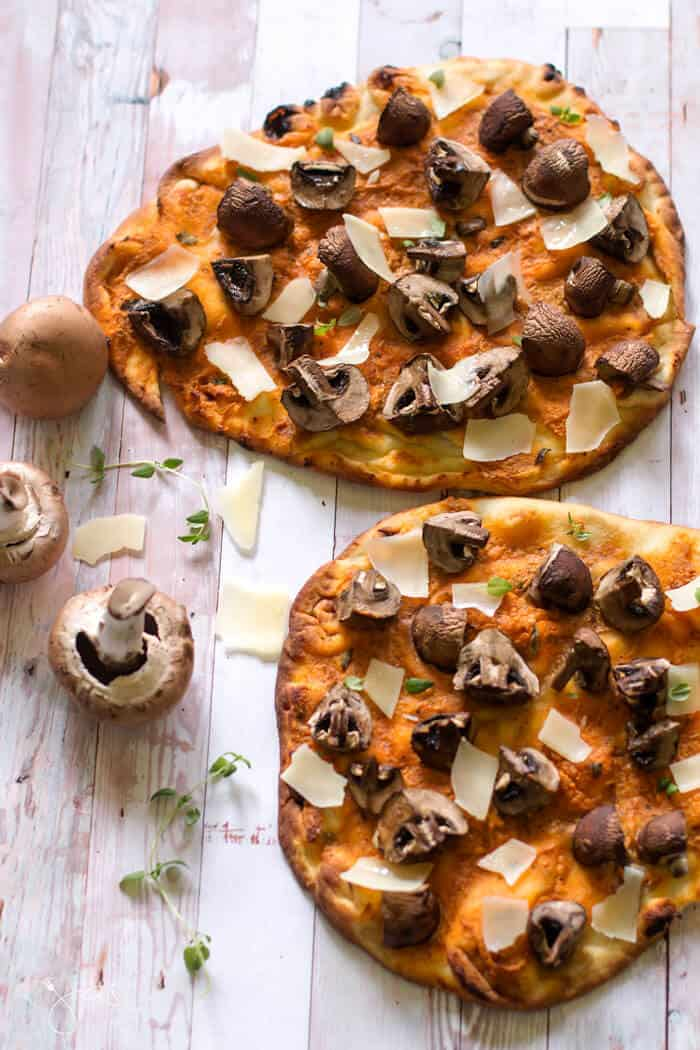 Delicious pizza ready in ten minutes made with naan flatbread, baby bella mushrooms and goat cheese