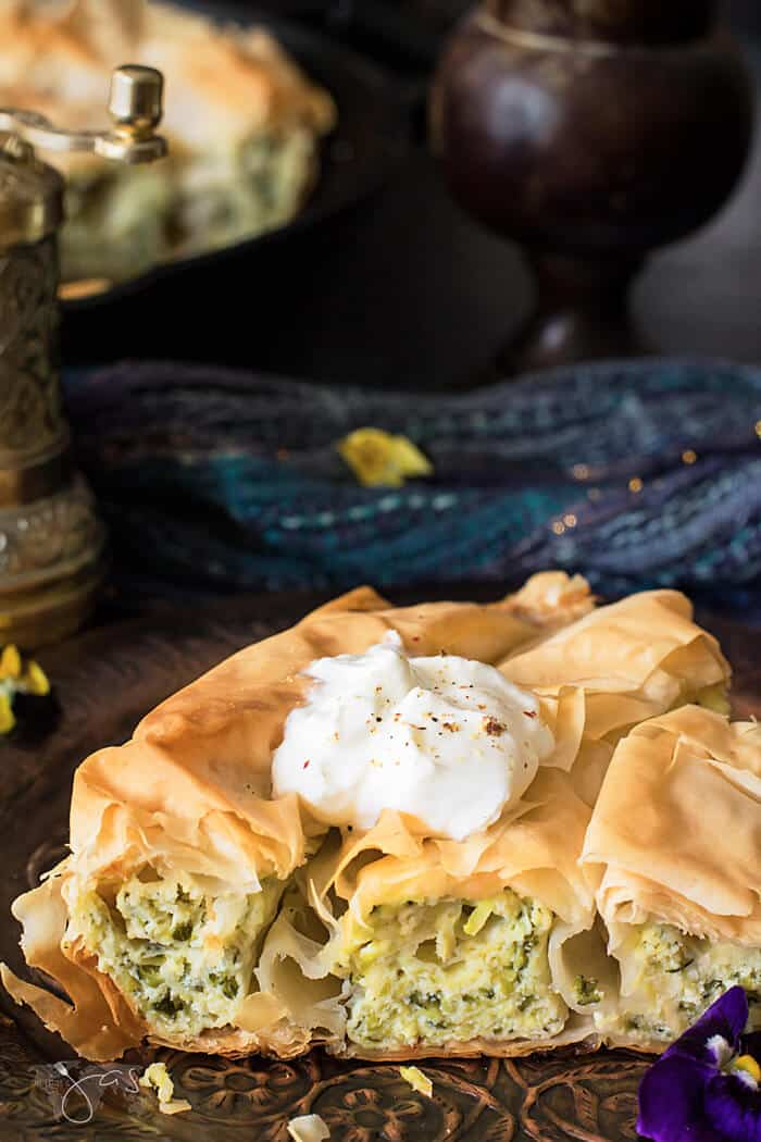 Greek fillo pie topped with sour cream