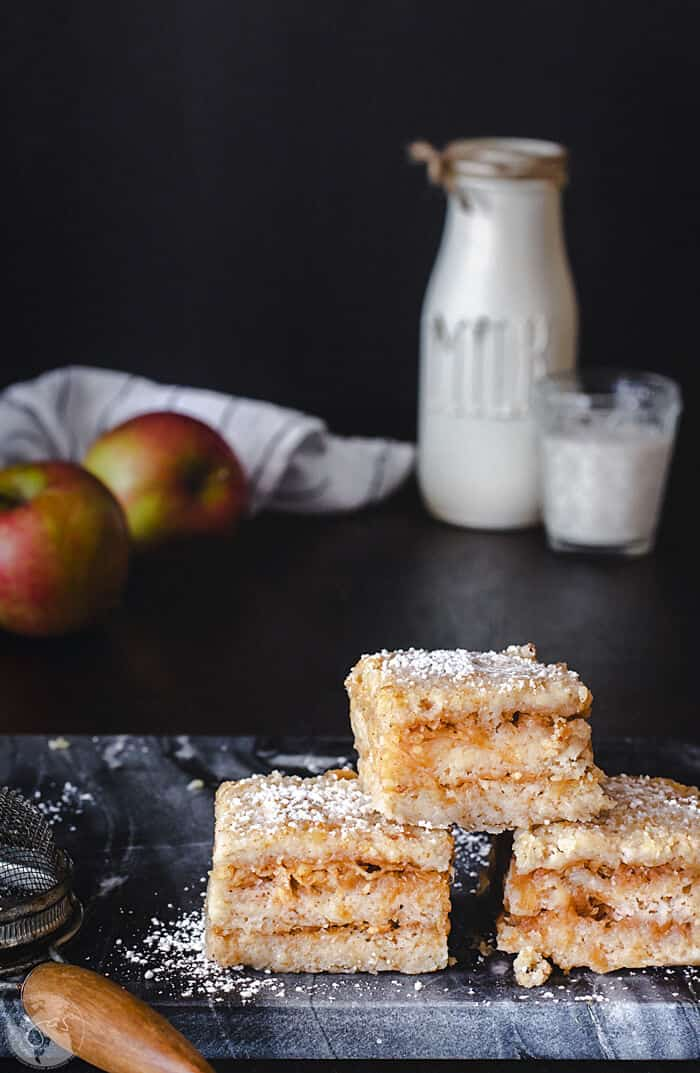 This Croatian easy eggless apple cake with semolina is a must-try! Make magic by layering dry ingredients with apples to yield a delicious and moist cake.