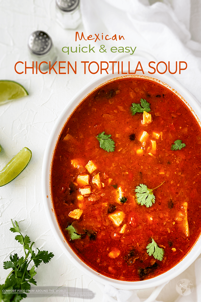 Quick and easy homemade chicken tortilla soup is classic comfort food. This hearty soup is loaded with Mexican flavors, chicken, beans, and spices, topped with cheese and baked tortilla strips for an effortless meal your whole family will love. | allthatsjas.com | #mexican #soup #tortilla #chicken #beans #homemade #quick #easy #recipes #recipeoftheday #allthatsjas #worldcuisine #easydinner #cincodemayo #spicy #avocado