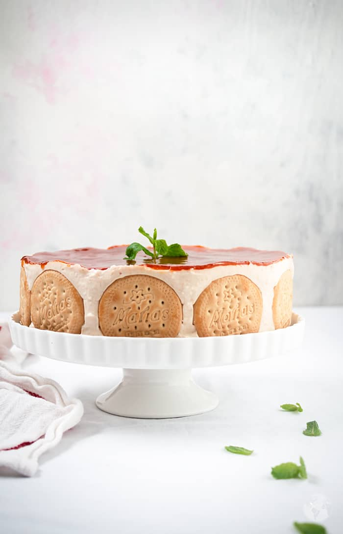 Mexican no-bake cake on a white stand and background.