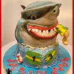 Sculpted Shark Eating Surfer Birthday Cake by All4Fun Cakes LLC 2016