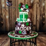 Footballs and Stars 16th Birthday Special Occasion Cake by All4Fun Cakes LLC