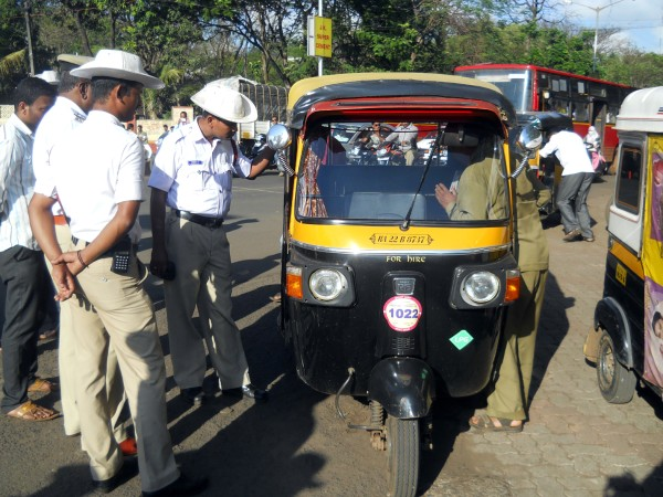 Police checking the Auto Meters at Belagavi