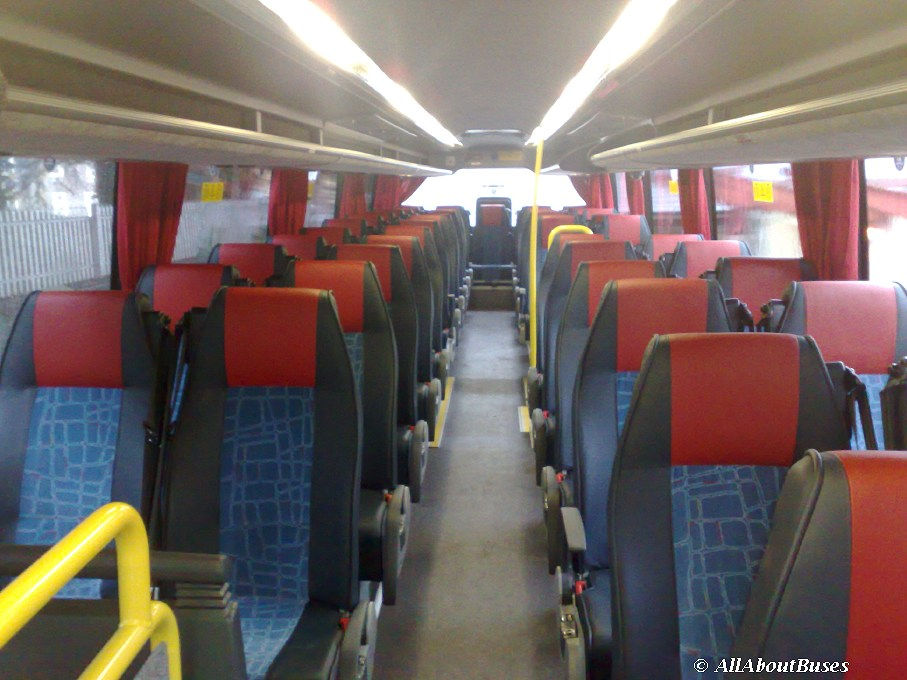 The upper deck is bright and airy, with comfortable seating, and fully belted.  Overhead racks are provided throughout.