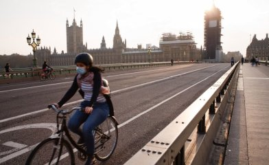 A cyclist wearing a face mask rides across a near-deserted Westminster Bridge in London, England, on April 8, 2020. With the country not predicted to reach its covid-19 coronavirus 'peak' for another week or more, the current lockdown conditions in place across the UK are widely expected to be extended in the coming days beyond the looming end, next Monday, of the three-week period of restrictions that was initially imposed. The matter is reportedly set to be addressed by Foreign Secretary Dominic Raab at Thursday's daily press conference. Raab is presently deputising for Prime Minister Boris Johnson, who tested positive for covid-19 last month and is currently in intensive care at St Thomas' Hospital in London. Across the UK, meanwhile, 60,733 people have now tested positive for the coronavirus, with 7,097 having died. (Photo by David Cliff/NurPhoto via Getty Images)