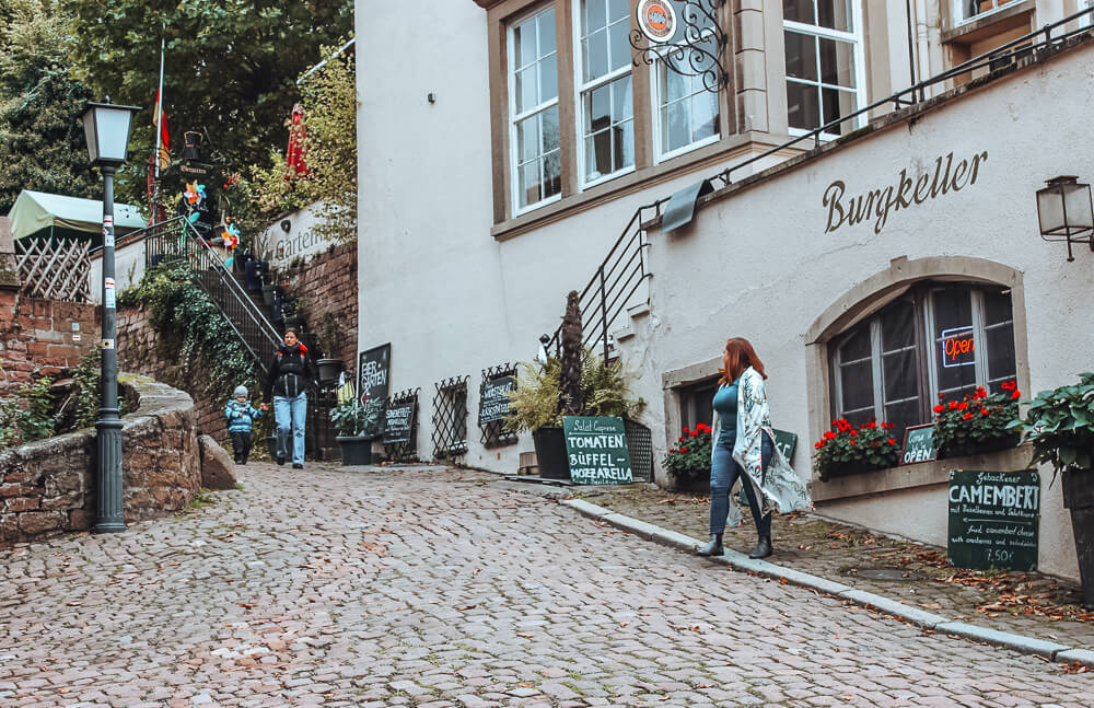 Woman wandering the cobbled streets of Heidelberg Germany