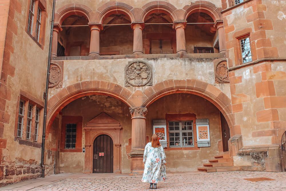 Woman looking up at Heidelberg Castle