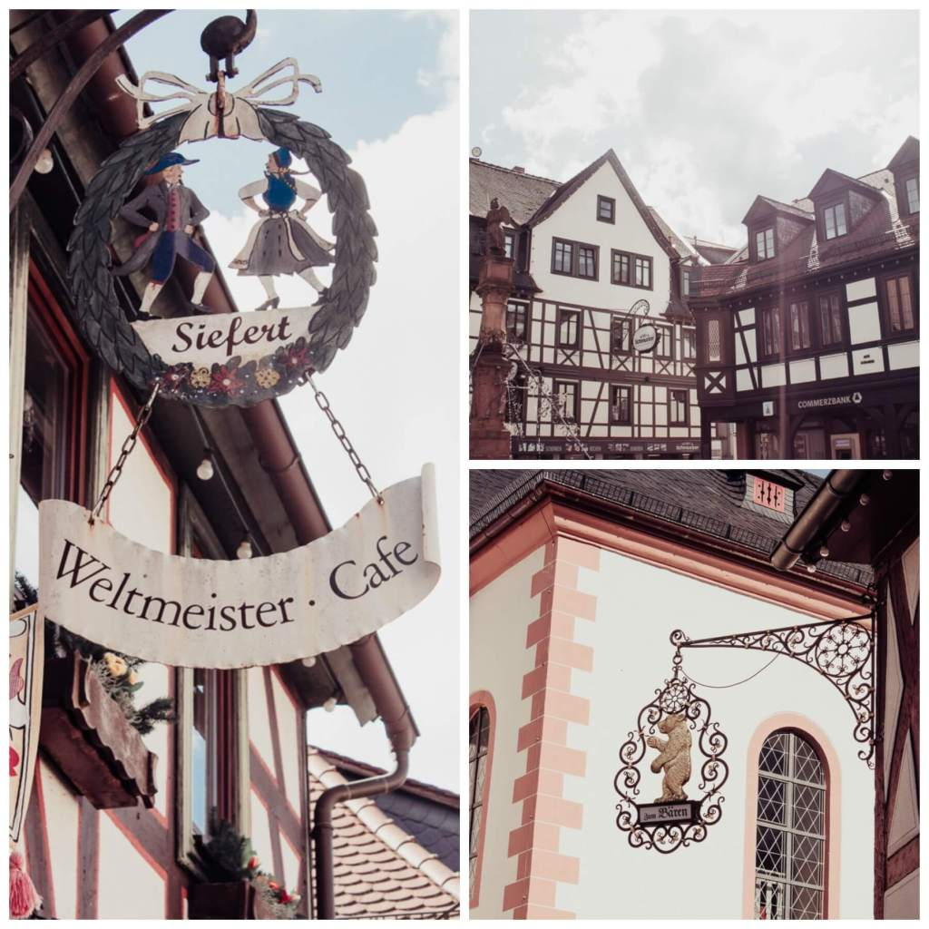 Ornate Shop signs hanging from the shops in Michelstadt Germany