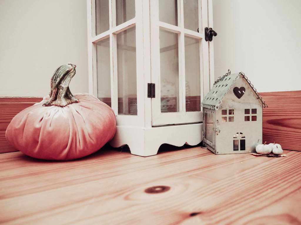 Add a velvet pumpkin to decorate your home for fall.