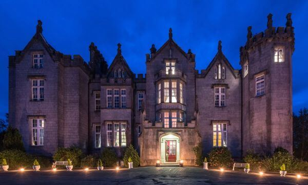 Exterior of Kinnitty Castle in Offaly at night, a haunted hotel in Ireland