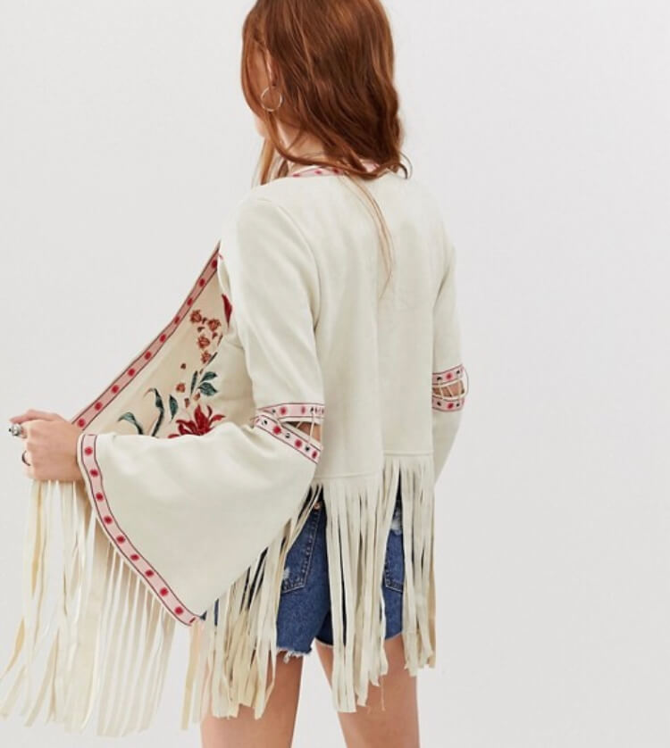 Glamorous embroidered festival jacket with floral embroidery. The perfect festival look. Read more on www.allaboutrosalilla.com