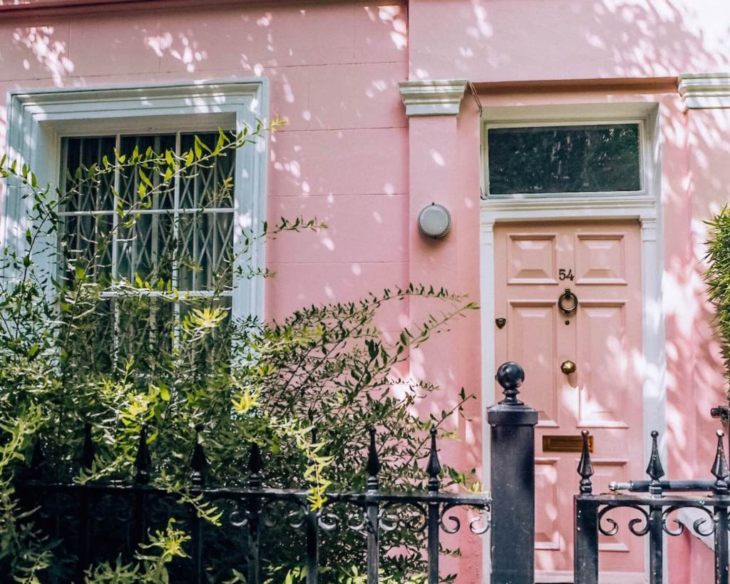 Pastel pink house at Number 54 Portobello Road. The pretty pastel houses of Notting Hill London.