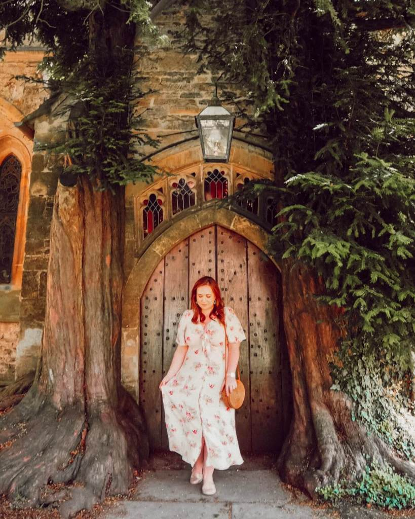 Door surrounded by yew trees at St Edwards church Stow on the Wold Cotswolds