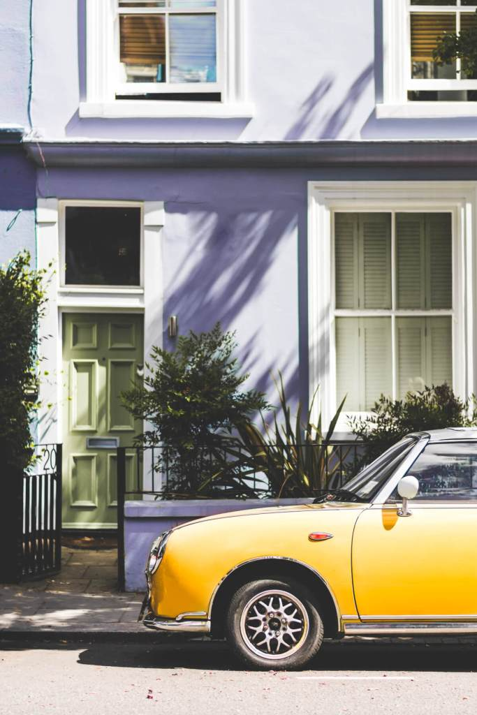 Pastel Blue house in Notting Hill London with a yellow car parked outside